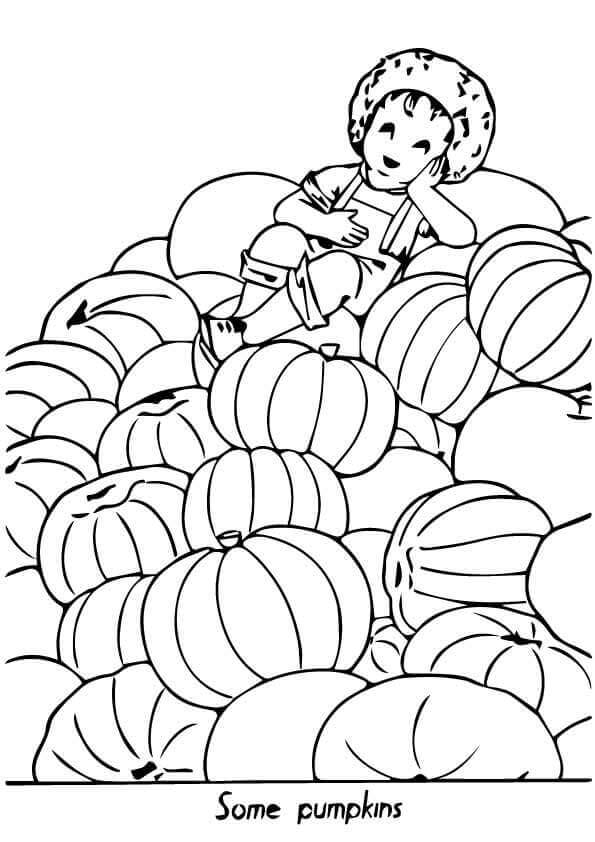Boy Resting On A Stack Of Pumpkins