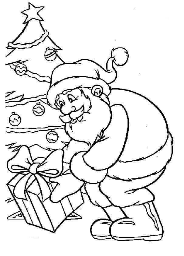 Santa Putting Christmas Gift Near The Tree